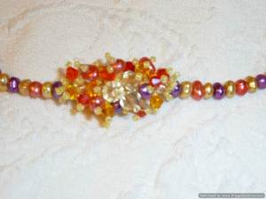 This is the focal piece in the mult-colored pearl necklace shown above