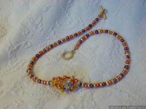 Multi-colored pearl necklace by Kristin with focal element.