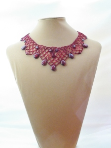 Ruby Picasso Necklace on display